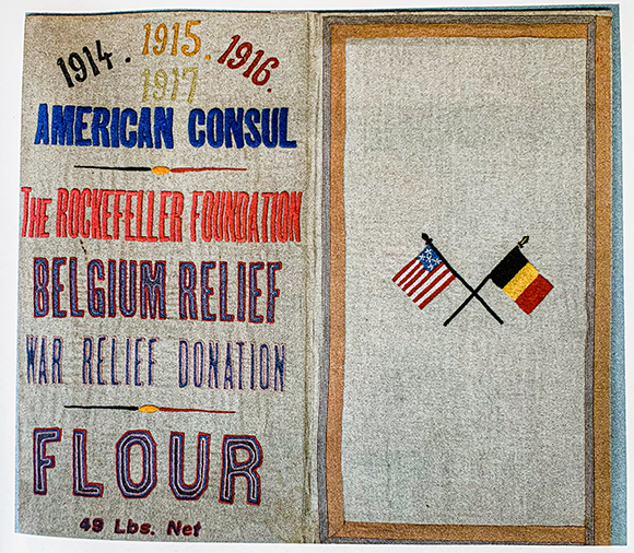 Flour sack embroidered by Belgian women in gratitude for U.S. famine relief aid during WWI.