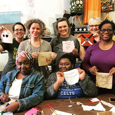 At one of public sewing sessions hosted by Bib & Tucker Sew-Op the University of Alabama at Birmingham's (UAB) Department of Art & Art History, participants show off the blocks they made to commemorate Loving Day. Photo from the UAB website.