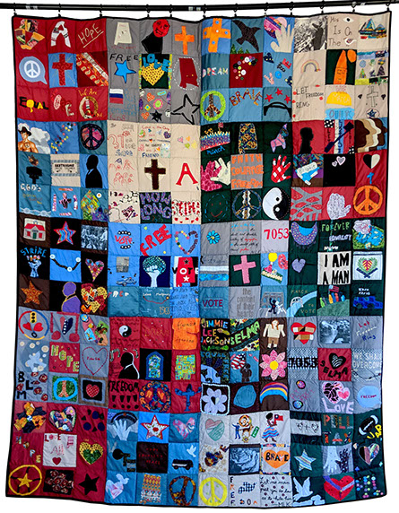 "March Quilt, 2015. ""This quilt hung in Montgomery and the blocks were arranged in such a way as to imply 'organization',"" explains Lillis Taylor. ""The quilt that hung in Selma was more patchwork and the Montgomery quilt has an order to it. We imagined that by the time the marchers got to Montgomery, their disparate selves had solidified into a more organized unit."" Photo by Lillis Taylor"