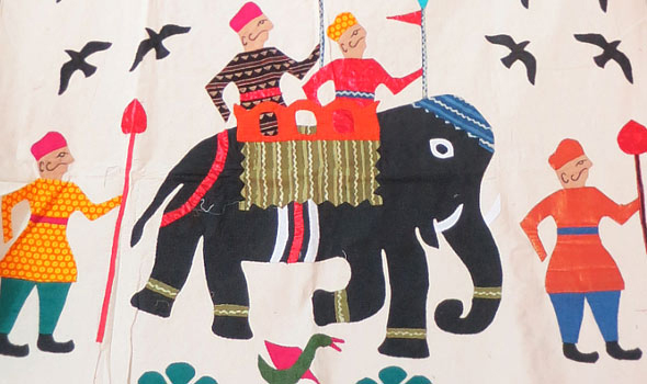 Traditional Gujarat appliqué might include colorful figures of people and animals stitched on a white ground and reflecting a distinctive cultural heritage.