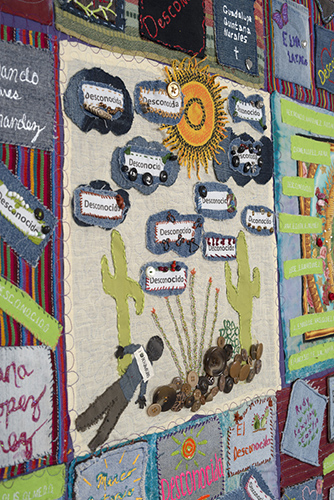 Detail from TUCSON SECTOR DEATHS 2006-2007, 237 deaths, 81.5″x 60″, made by the Tucson Community, Jody Ipsen, Diana Rix, Laurel Wilson, Sharon K Peake, and Rev. Bobbi W. Hargleroad of Tucson, Arizona.