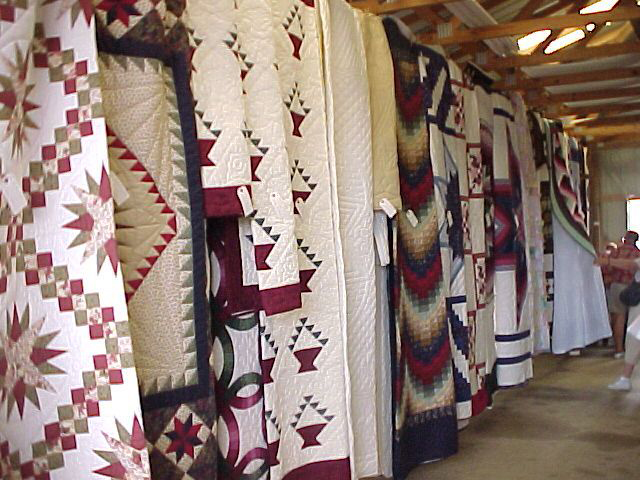 The highlight of the annual Clarita Amish School Auction, Crafts, and Antique Show is when as many as 100 quilts handmade by Amish women go on the auction block.